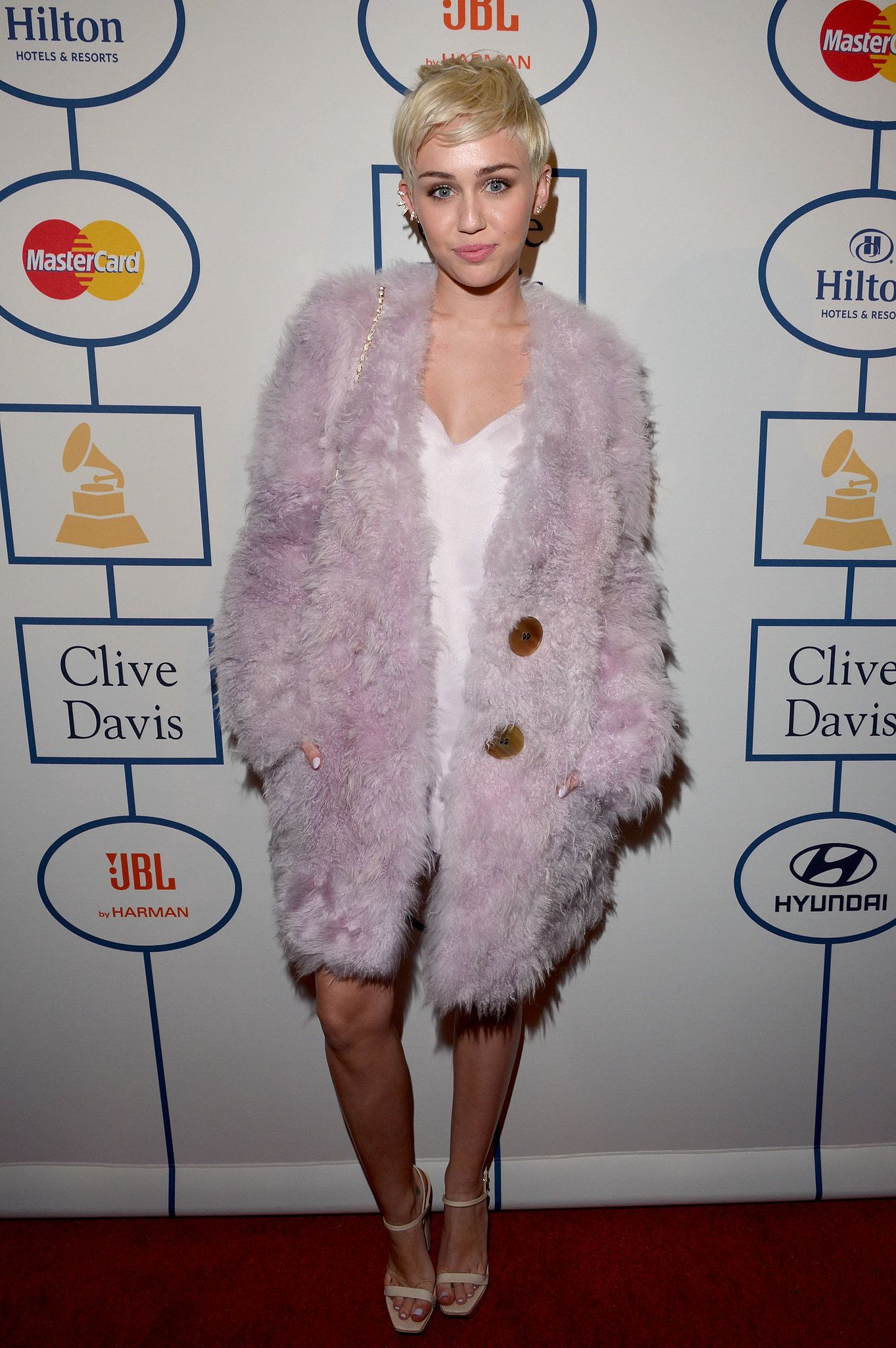 Miley Cyrus - 56th Annual Grammy Awards Pre-Grammy Gala and Salute to Industry Icons honoring Lucian Grainge in LA 25 January 2014 in  in Calvin Klein Collection Pre-Fall 2014 Dress & Coat, Chanel No.5 Perfume Bottle Bag, Calvin Klein Heels