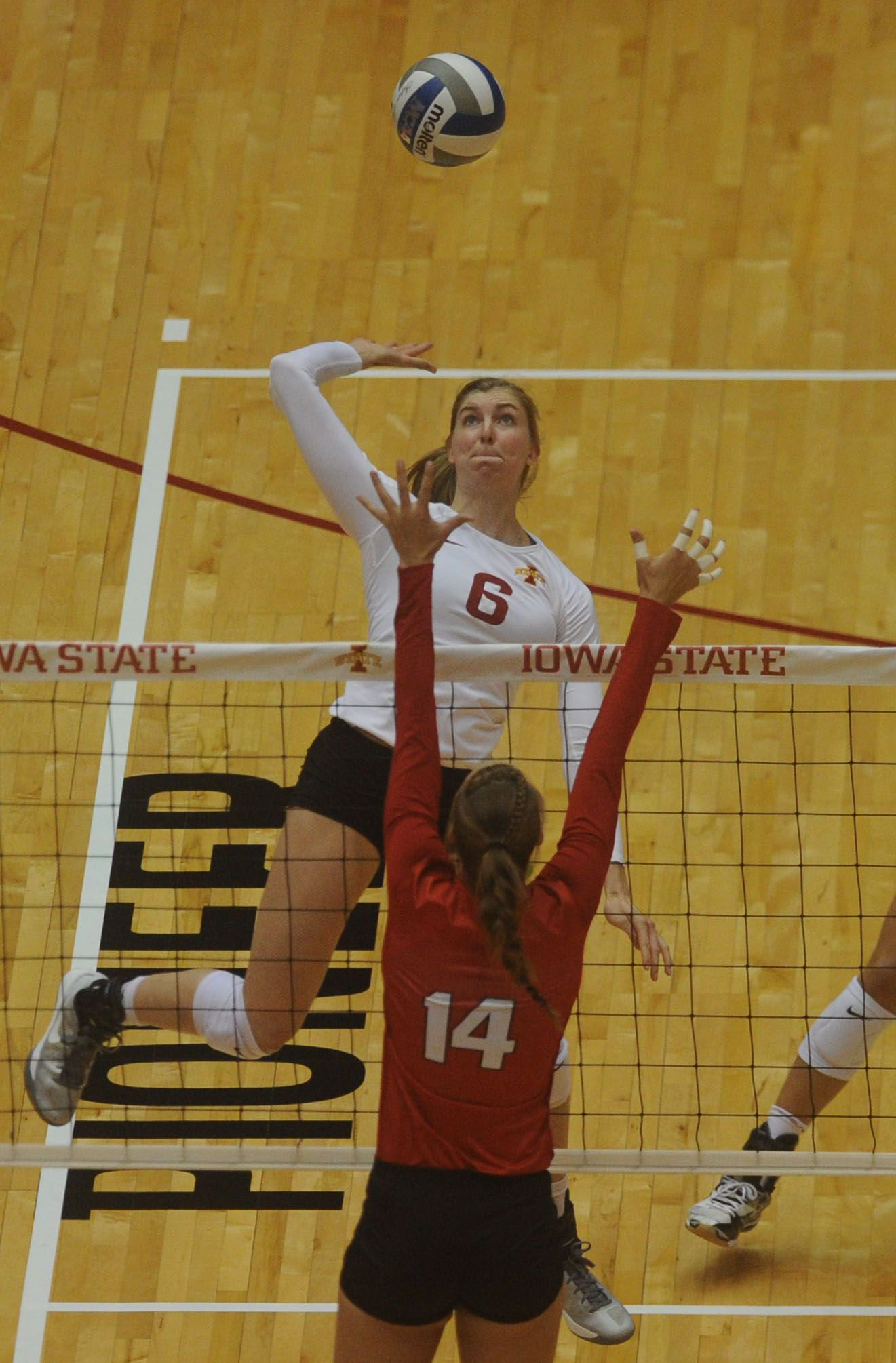 Iowa State S Outside Hitter Alexis Conaway Spikes The Ball Over Nebraska S Outside Hitter Kelsey Fien During Second Set At Hilton With Images Iowa State Iowa State Cyclones