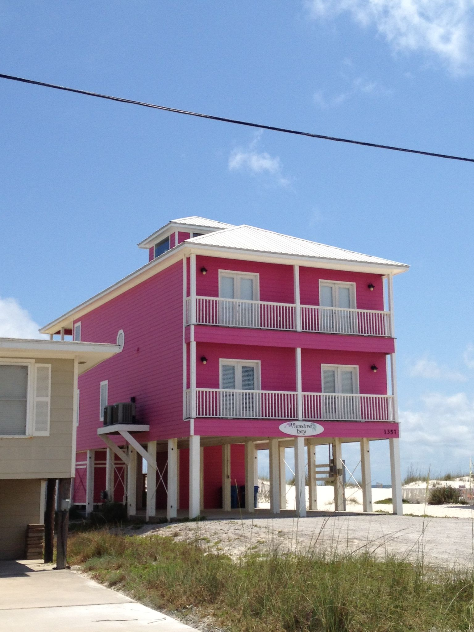 Hot pink beach house in gulf shores Alabama for sale offers a special beach  get away or rental investment! Fall In love.