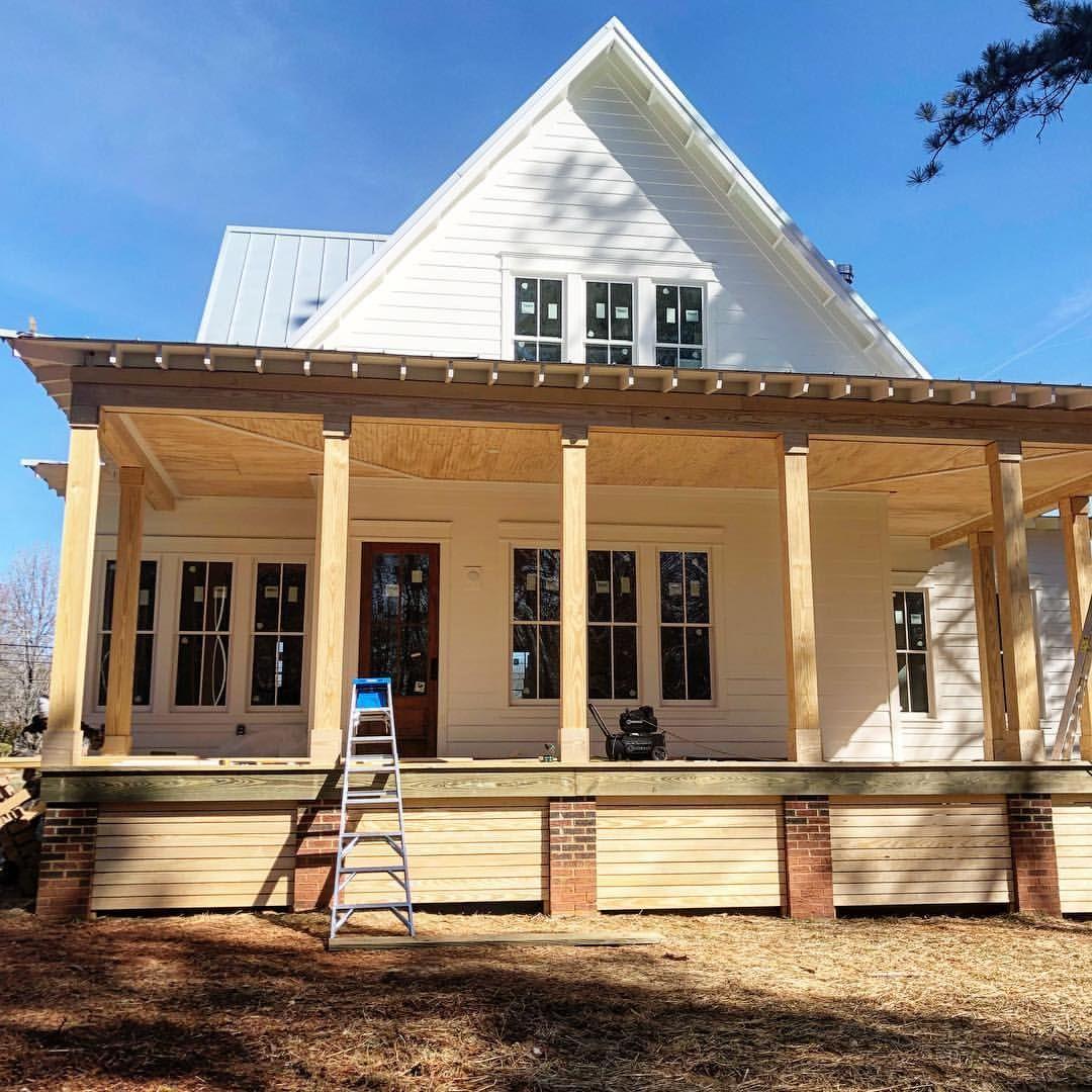 White farmhouse four gables house plan back porch and