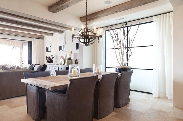 Rustic Cottage Dining Room Features An Iron Sphere Pendant Impressive Slipcovered Dining Room Chairs Design Decoration