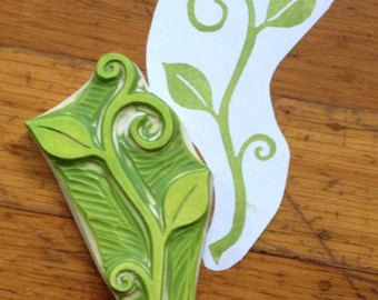 Includes 1 Holly Leaf Stamp Measurements: 3 long Hand carved into durable rubber. Perfect for many paper and fabric projects. This stamp is