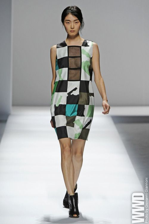 Sportmax RTW Spring 2013  Contemporary architecture was the main reference, and it played out rather literally in clean lines, controlled volumes and the odd flash of hardware.