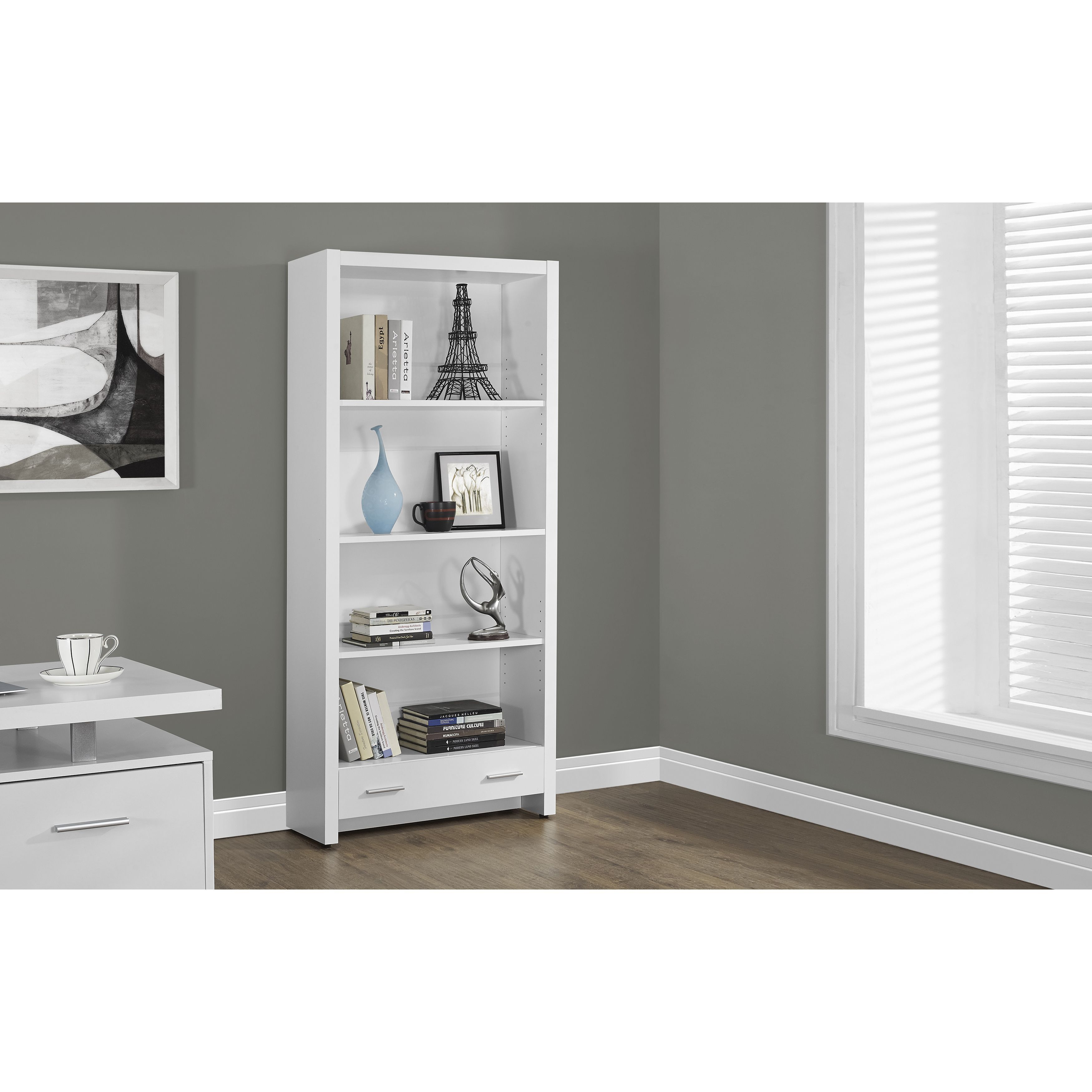 Add a modern touch to your decor with this white tier bookcase