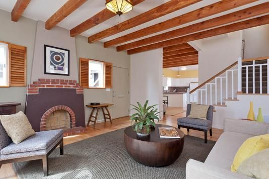 Love the exposed beams and brick in this traditional home - Oakland community college interior design ...