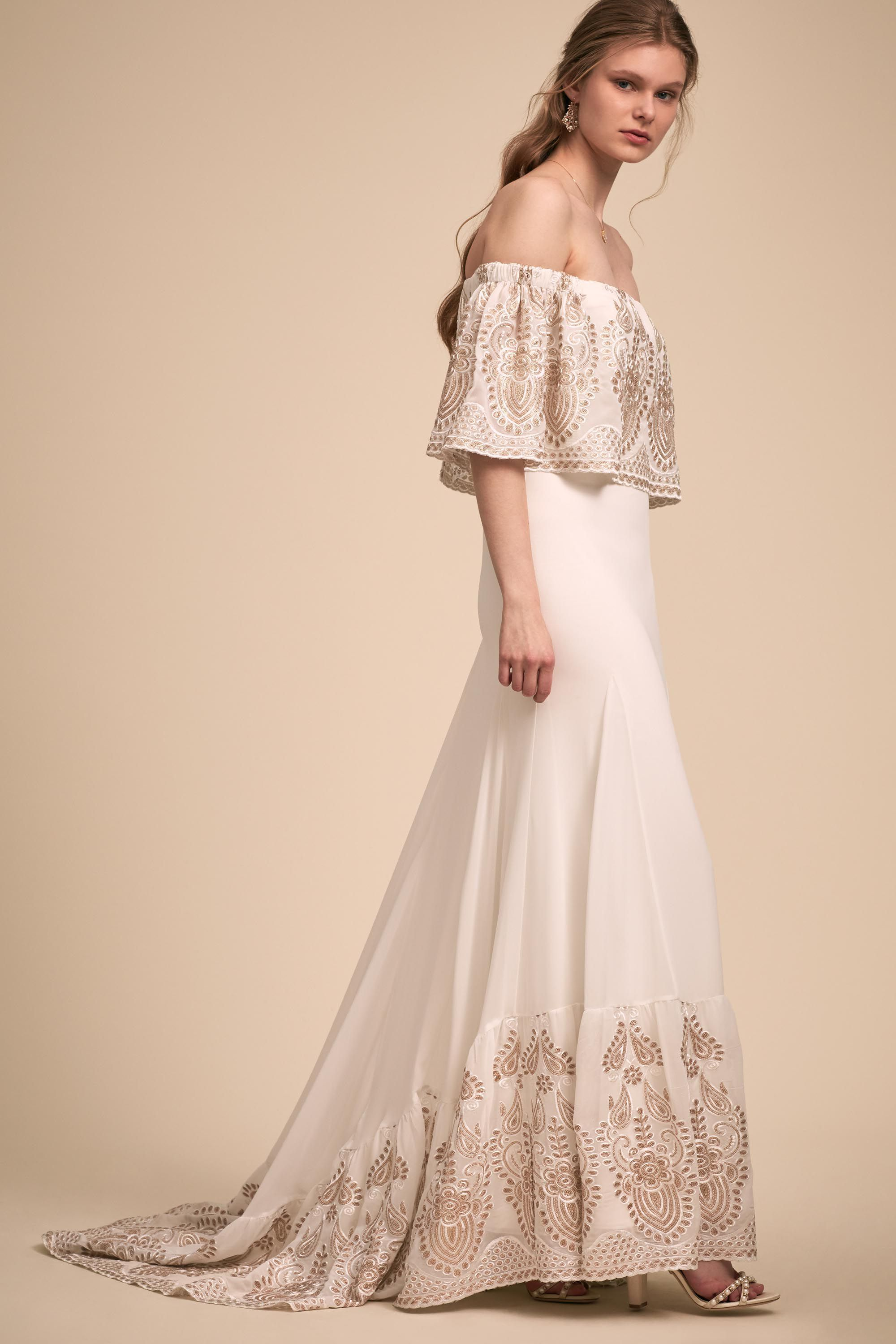 The flouncy lace overlay and hemline on this offtheshoulder gown