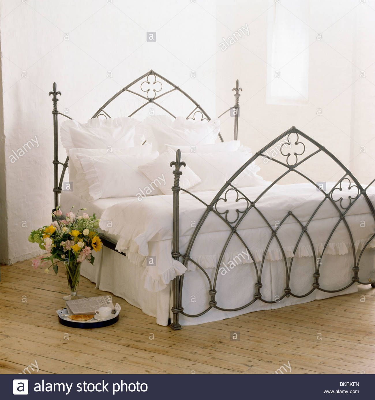 Gothic Style Black Wrought Iron Bed With White Linen In Modern