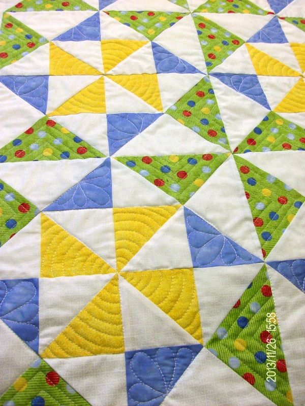 Handmade pinwheel baby quilt with beautiful free motion ...