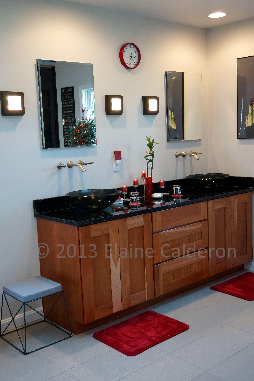 Medallion Designer Cabinetry Sonoma Cherry Door Natural Finish. Black Lectea Granite