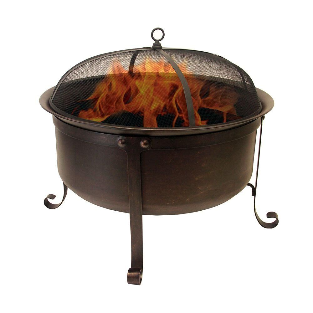 Home Depot Fire Pit Hampton Bay Welton 34 In Round Cauldron Fire Pit Shows A Man