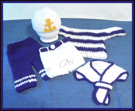 Newborn Crochet Sailor outfit includes Pants, Shorts, Sweater, Hat and Collar. Pants are blue with white stripes. Shorts are slip on with belt loops