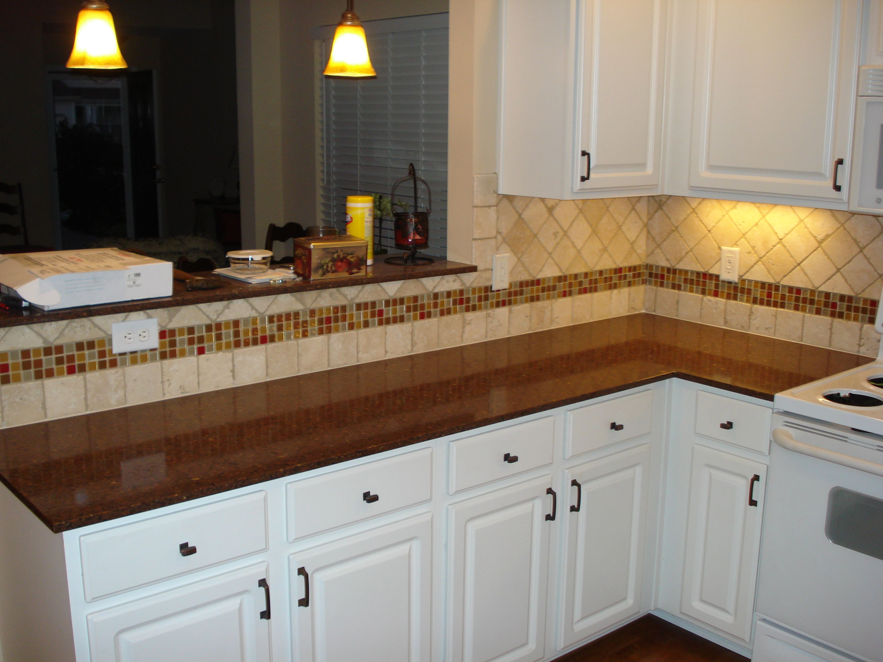 Kitchen Backsplash Accents tumbled marble backsplash with multi-colored glass accent strip