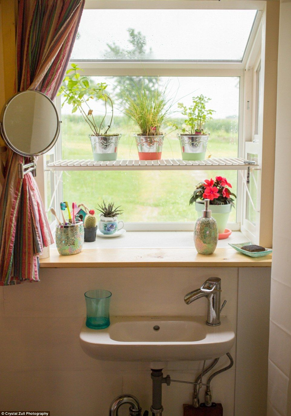 Natural beauty: Thelarge garden window in the bathroom gives off plenty of natural light and is perfect for storing potted plants and flowers