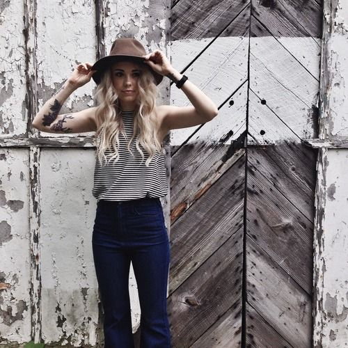 So much perf. Dark high waisted flare denim, black and white stripe sleeveless muscle tank, tattoos, and I actually like the hat. Sundays Pearl