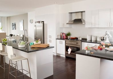 Bright and white kitchen design with stainless steel appliances ...