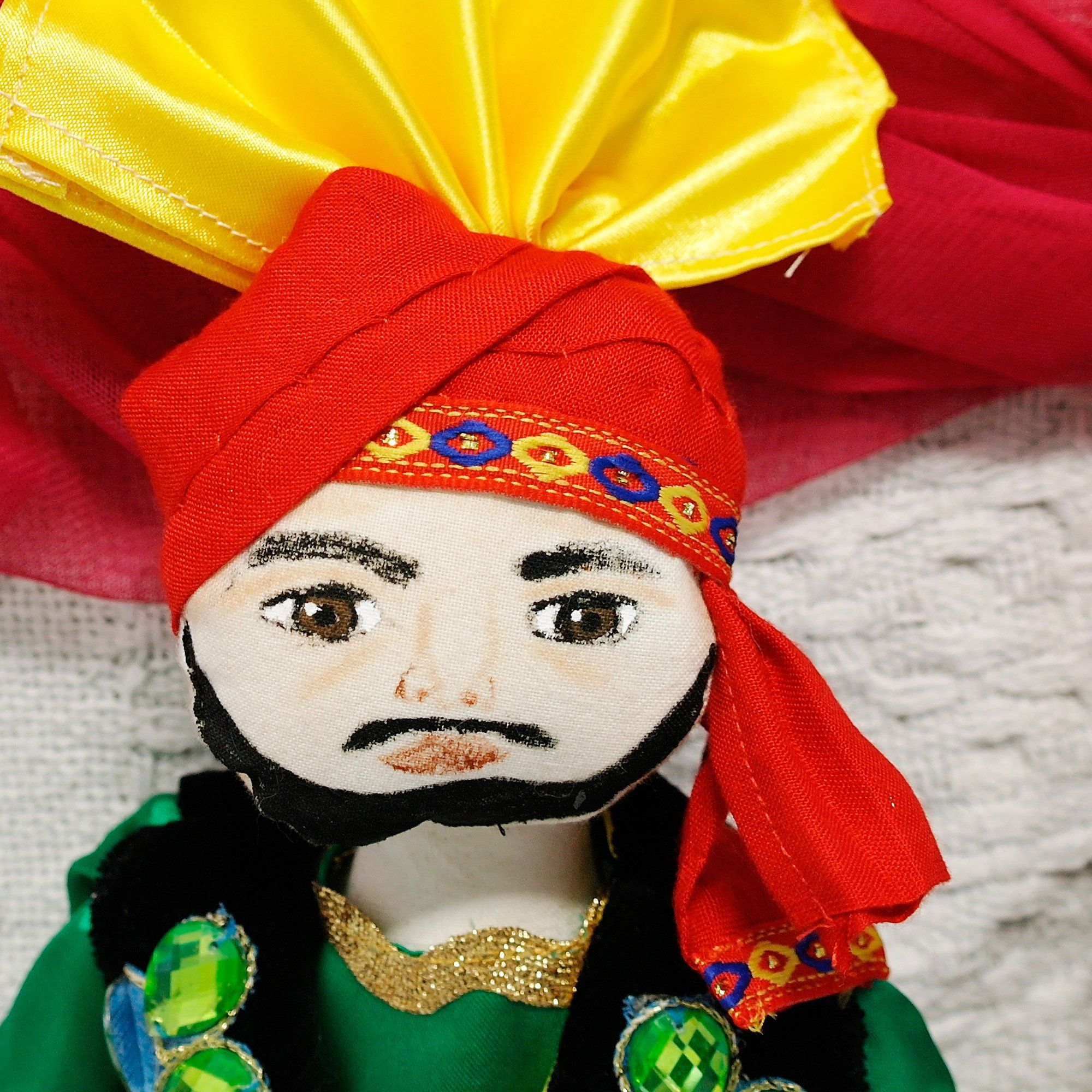 Bhangra Doll,Male Indian Doll, Handmade Dancer, Cloth Art Doll, Ethnic male doll, Authentically handmade Indian dancer, Exotic male dancer is part of Male Clothes Art -  Namaste , My name is Anokh and I'm from the third generation of Punjabi Dancers We sing and dance a lot at home and we all play the dholki I love football and cricket and play for my local team  My dhoti suit is made from satin and the waistcoat is velvet with a hand embroidered emblem on the back of our dance group It is fully lined We have a routine where we take them off at the end of the dance and just throw them high up into the air  Ha !We dance at parties weddings and are now taking bookings for Barmitzvahs! Anokh 114gms Dhoti, Shirt, Waistband Satin Waistcoat Velvet Satin Sequins Headdress Satin Cotton Height 40cm All doll cloth bodies are all made of cotton, Waldorf Jersey, Tilda Fabric or Kona Cotton  All doll filling is Supa Soft It is100% polyester filling Nonallergic, nontoxic flame retardant and manufactured to B S  1425, B S  5852 & EN 71  PT 2 All hair is made of Acrylic wool  Faces are hand embroidered or handpainted using textile paints  All jewelry is a combination of sequins, beads, pearls and diamante and artificial jewelry  All footwear is made of felt, wood or fur