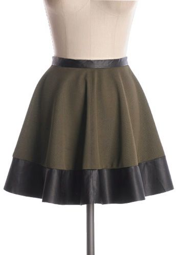 Girly with some edge! Fun and versatile polyester and vinyl skater skirt. Main 100% polyester; trim 100% vinyl Not stretchy Not lined Dry clean only Shop Cute Dresses and Clothing - Canada Graffiti Artist Skirt in Olive -
