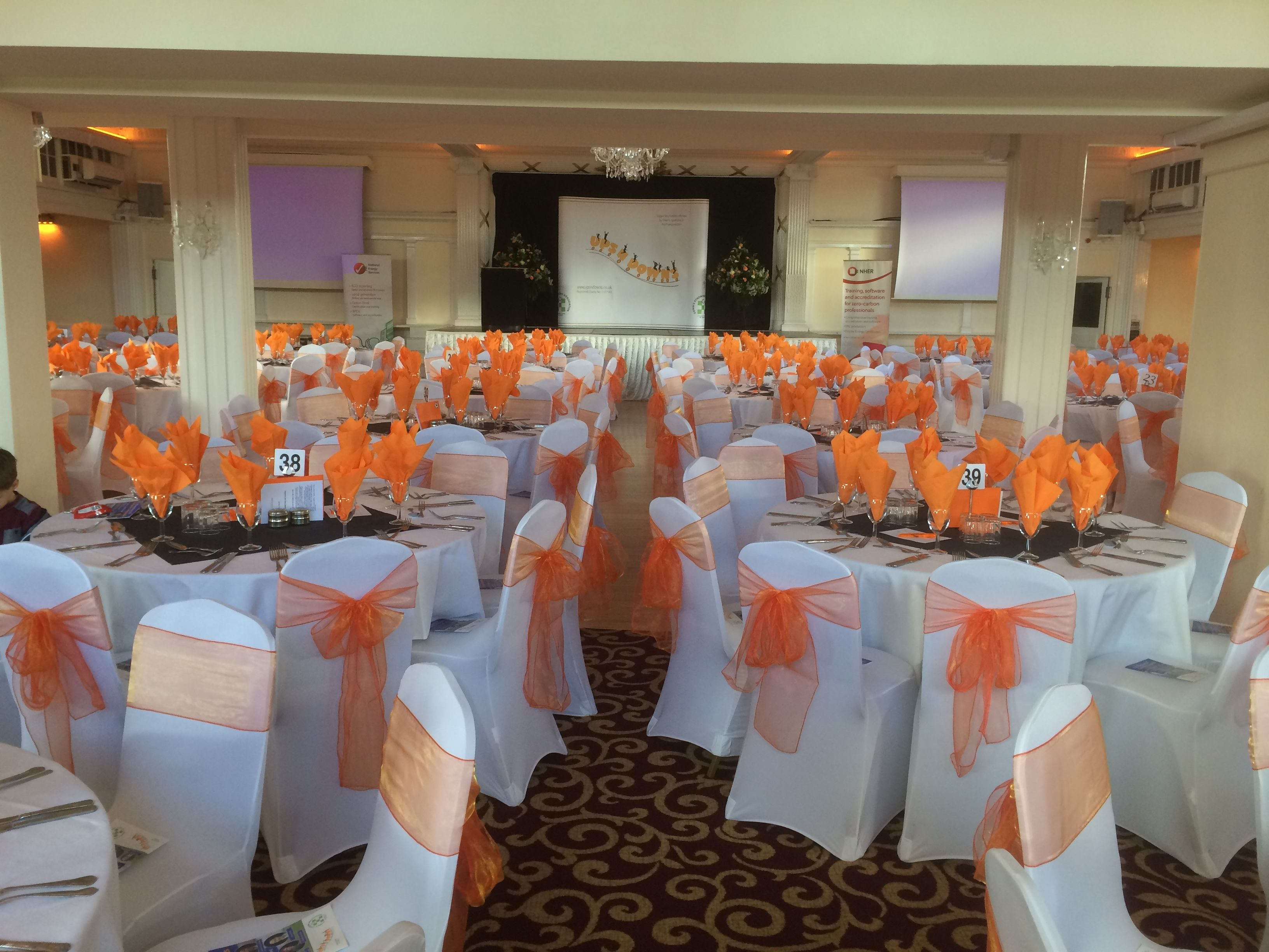 chair covers hire in wolverhampton unfinished childs rocking beautiful white with coral orange organza sashes wicksteed park kettering corporate event