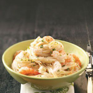 """Shrimp Fettuccine Alfredo #shrimpfettuccine """"This has always been a favorite, so when I started cooking healthier, I tried different ways to lighten it. Less butter and fat-free half-and-half worked well, along with using a little flour to thicken the sauce.  Evelyn Slade - Fruita, CO #shrimpfettuccine Shrimp Fettuccine Alfredo #shrimpfettuccine """"This has always been a favorite, so when I started cooking healthier, I tried different ways to lighten it. Less butter and fat-free half-and-half #shrimpfettuccine"""