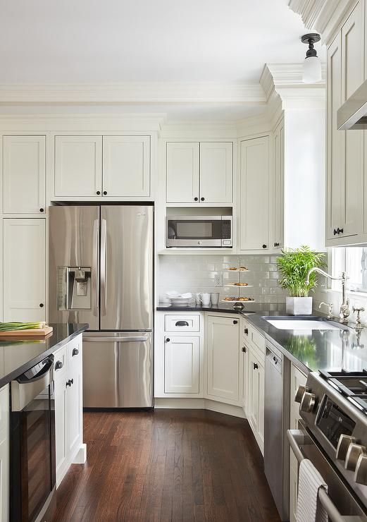 Off White Shaker Island Cabinets Are Adorned With Oil