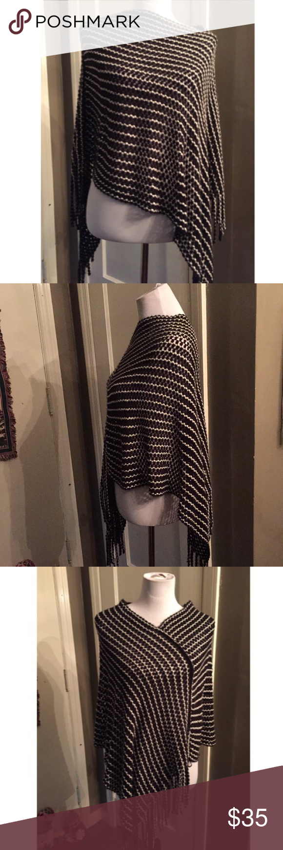Steve Madden black/white fringed poncho OSFM Worn once. No flaws.  Black/white striped pattern with fringed hemline.  Open knit construction.  Super soft, and looks amazing with jeans or leggings, and boots.  Can be worn a bunch of different ways.  Thank so much!! Steve Madden Sweaters Shrugs & Ponchos