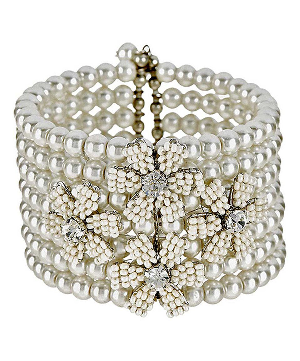 Look at this #zulilyfind! Vintage Addiction Cream Floral Bead Stretch Bracelet by Vintage Addiction #zulilyfinds