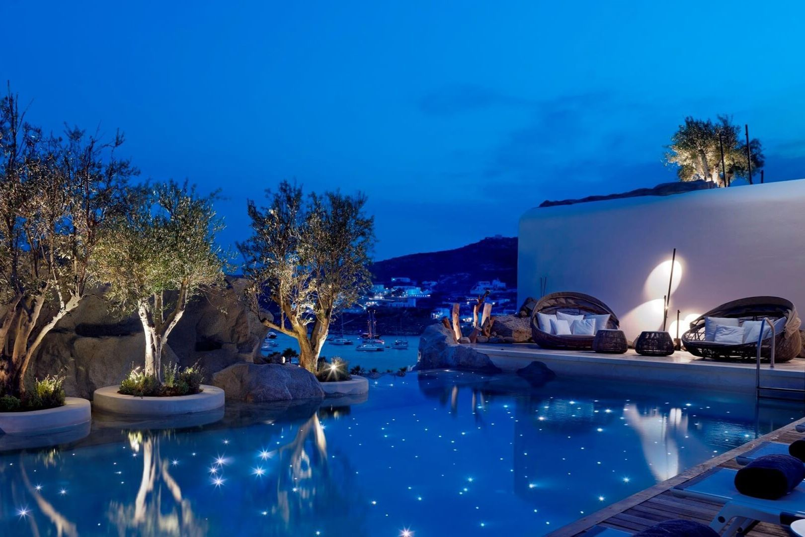 """The starlit infinity pool built into the rocks and overlooking the sea at [link url=""""https://www.kenshomykonos.com/""""]Kenshō Mykonos[/link], a new boutique hotel on the Greek party island"""