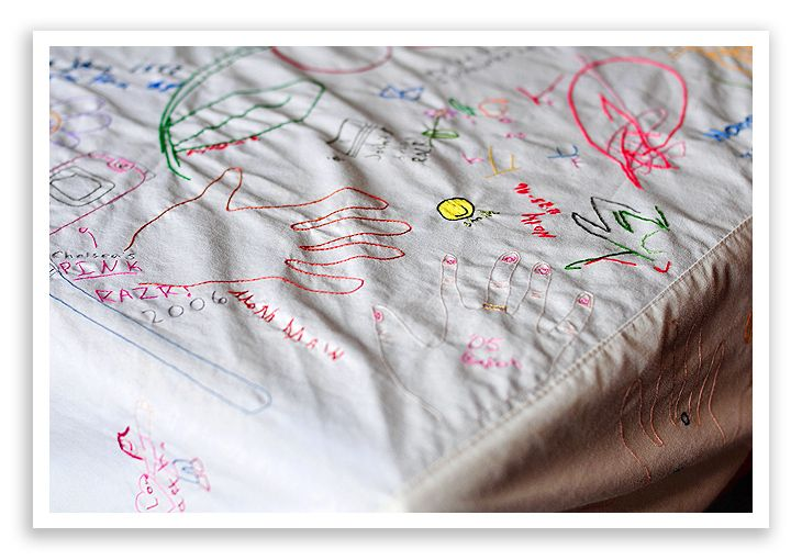 Great tradition - a sheeting tablecloth that everyone doodles on each year, and then gets embroidered.  What a fab family memory!