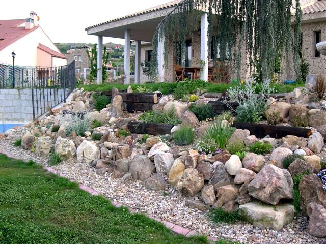 steingarten haus hang ziergräser kies beispiel | gardening, Hause und Garten