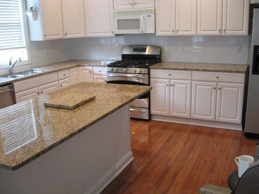 White Kitchen Light Granite santa cecilia granite countertops white cabinets with light
