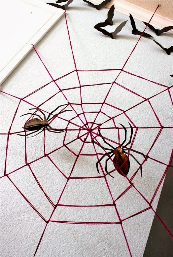 Maybe we could do this with our big spider this year!! Party ideas - halloween office decorations