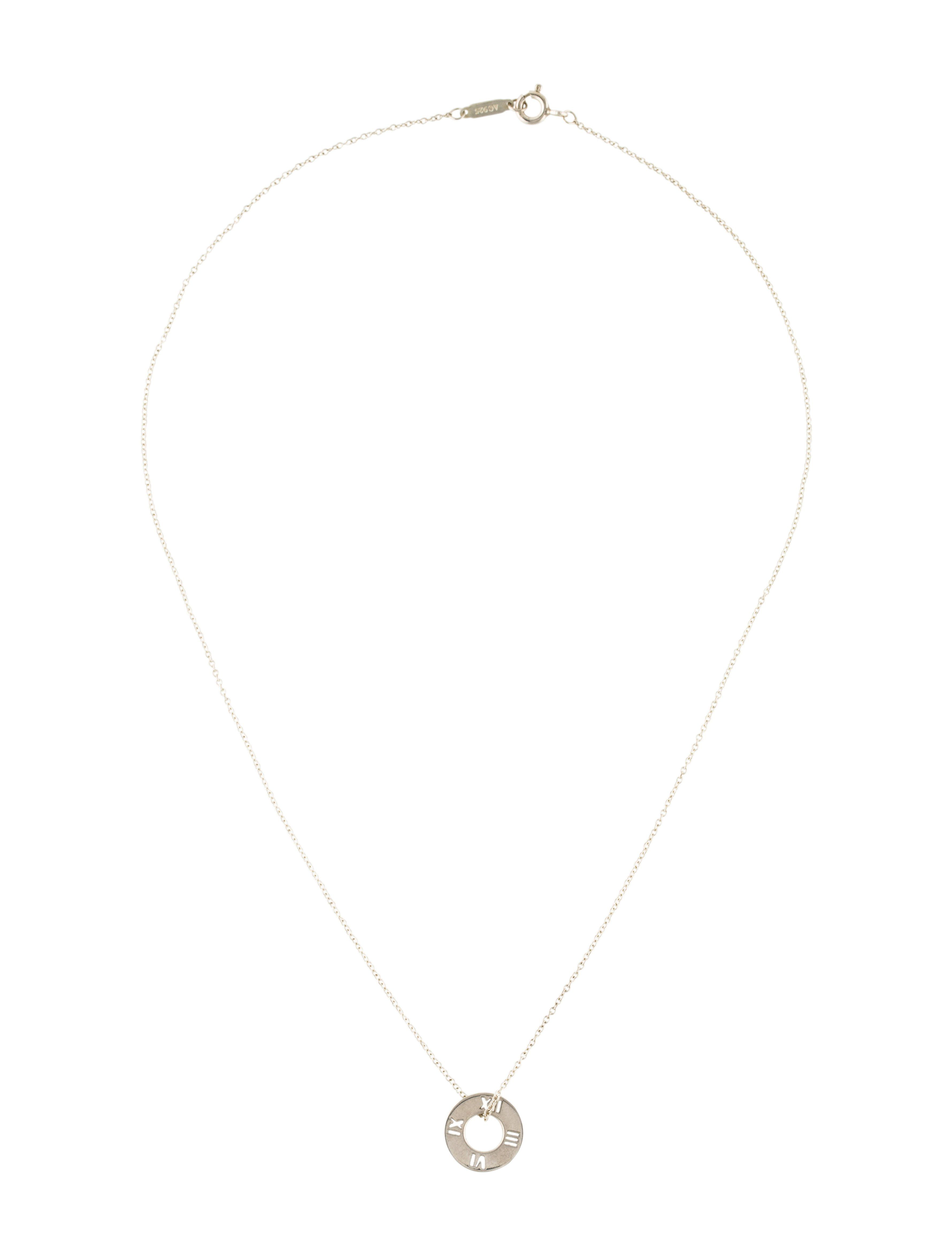 d1cbb0eac Sterling silver Tiffany & Co. Atlas Pierced pendant necklace featuring  engraved Roman numeral motifs at removable round pendant, rolo chain and  spring rin