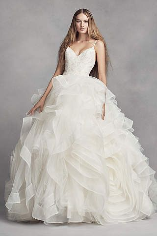 Perfect More than yards of tulle bined with cascading horsehair trim give the skirt of this White by Vera Wang ball gown its frothy volume