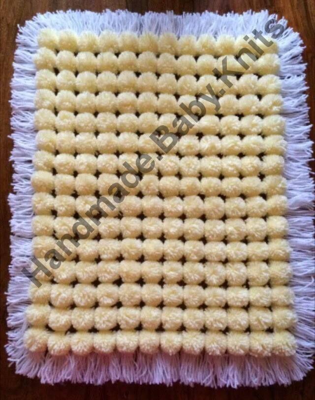 lemon pom pom blanket with white base and tassles