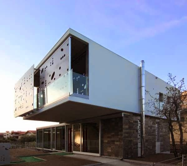 MODERN AND INNOVATIVE HOME DESIGN COMBINES CONTEMPORARY AND UNUSUAL  ELEMENTS IN ITS TWO STOREY DESIGN