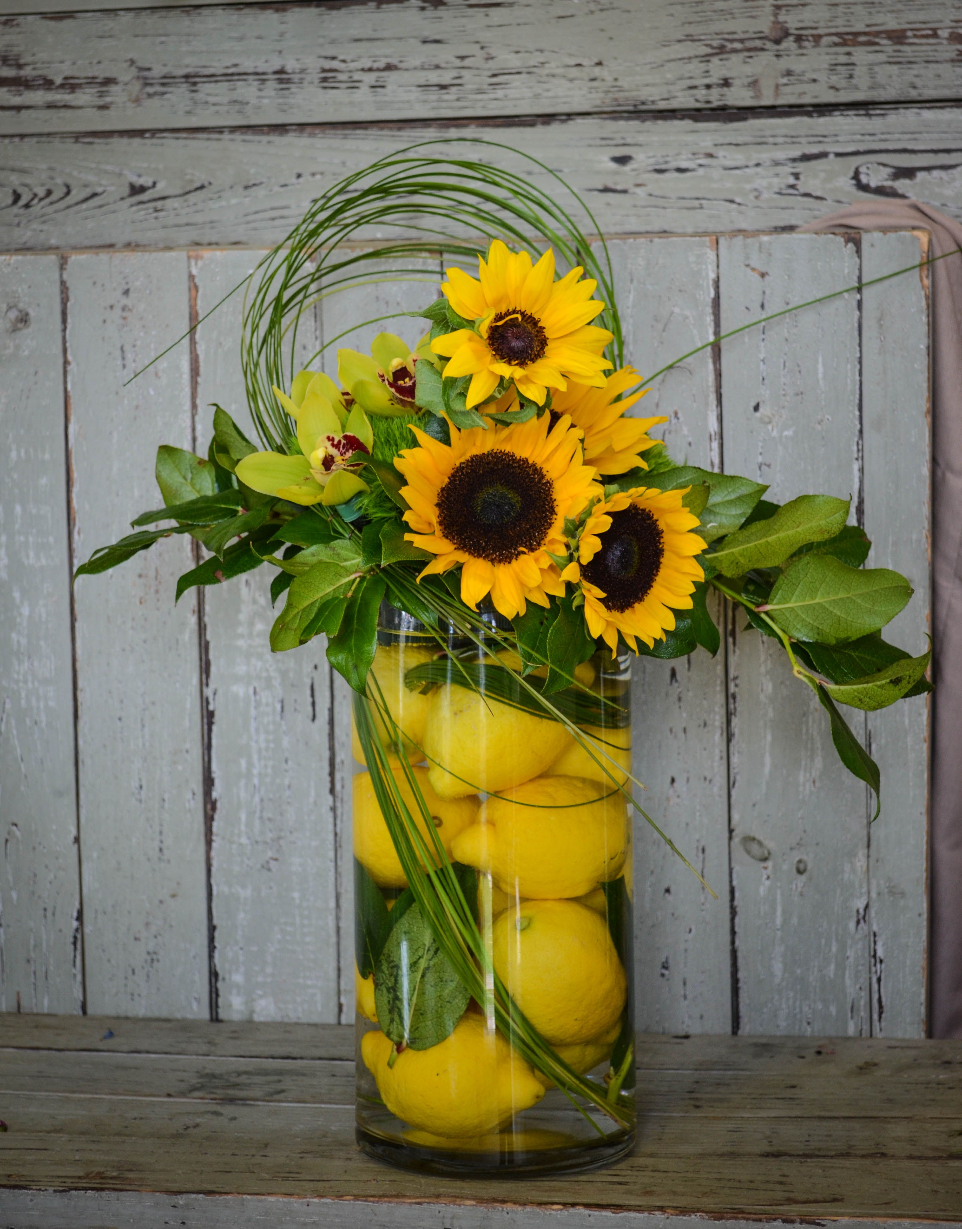 Citrus is in! Lemons, sunflowers and orchids with bear