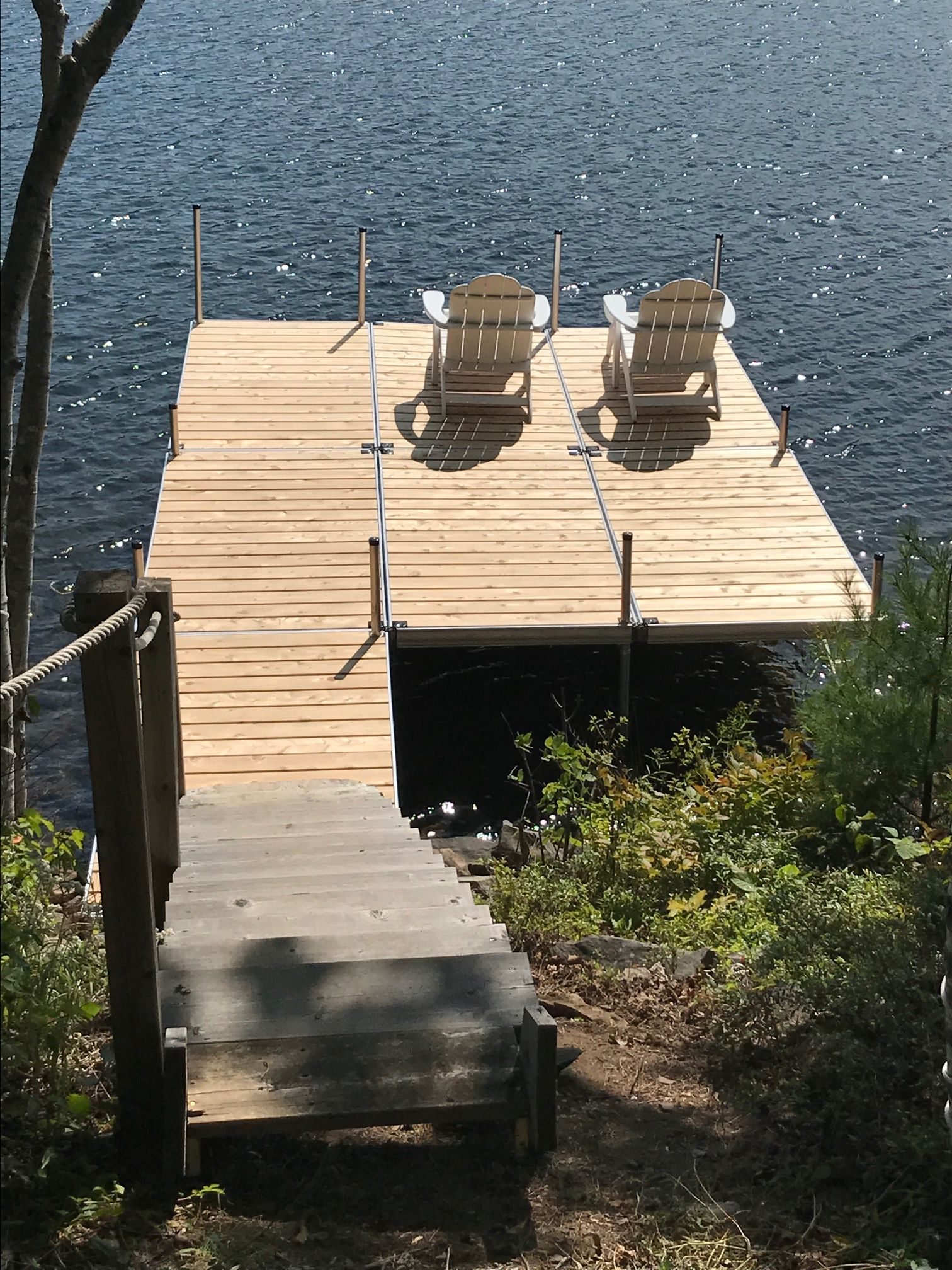 A Nice New Aluminum Dock With Cedar Decking And A Couple Of