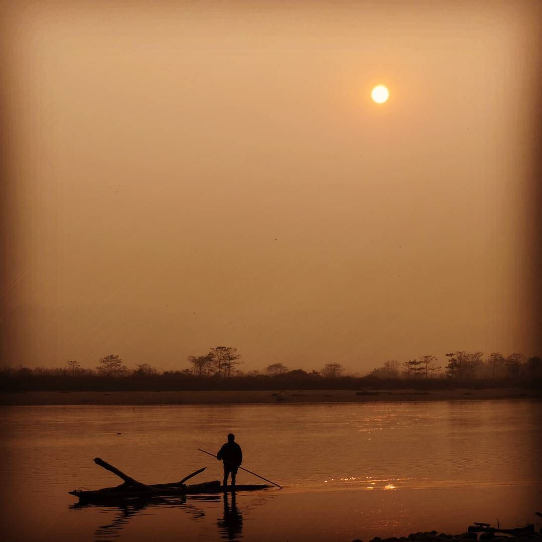 Sunset over the river #nepal #chitwan #boat #boatrides #locals #rowing #gadventures #travel #gadventures #travel #river #sunset by bayoung04