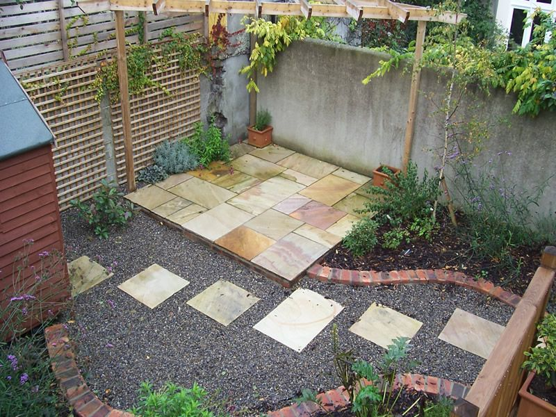 Good Pebbles, Paving Stones, Potted Plants And Patches Of Garden Minimalist  Garden, Garden Stones