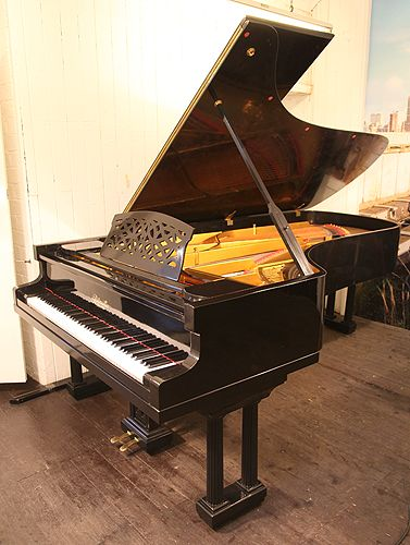 A 1922 Ritmuller Concert Grand Piano With A Black Case
