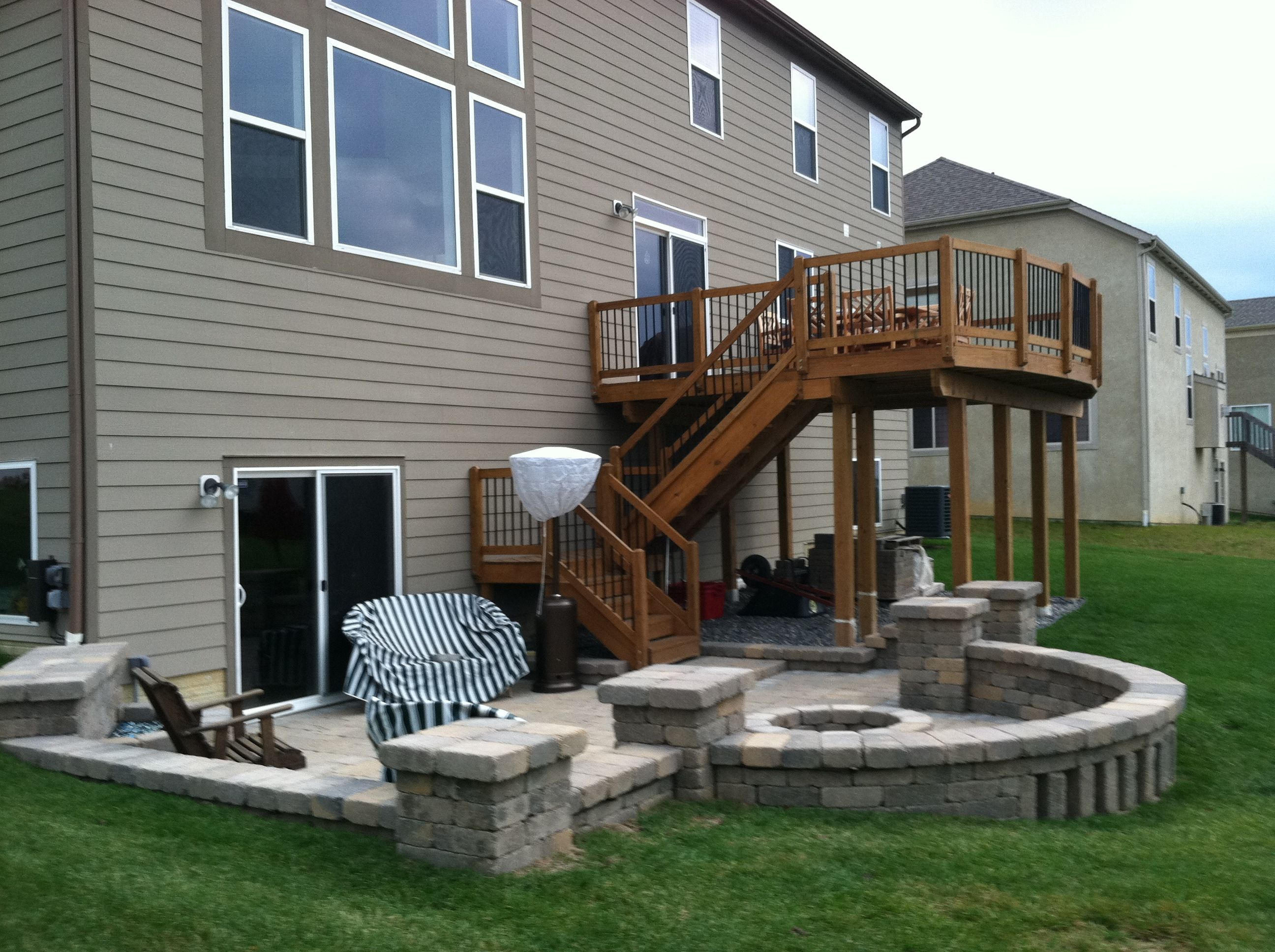 Second story deck above a paver patio www.creative ... on 2 Level Backyard Ideas id=84530