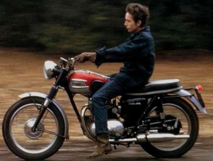♡♥Bob Dylan rides his red and silver 1964  Triumph Tiger 100  motorcycle -  click on pic to see a larger pic with a few more pics and the story of Bob  ... 560280f53