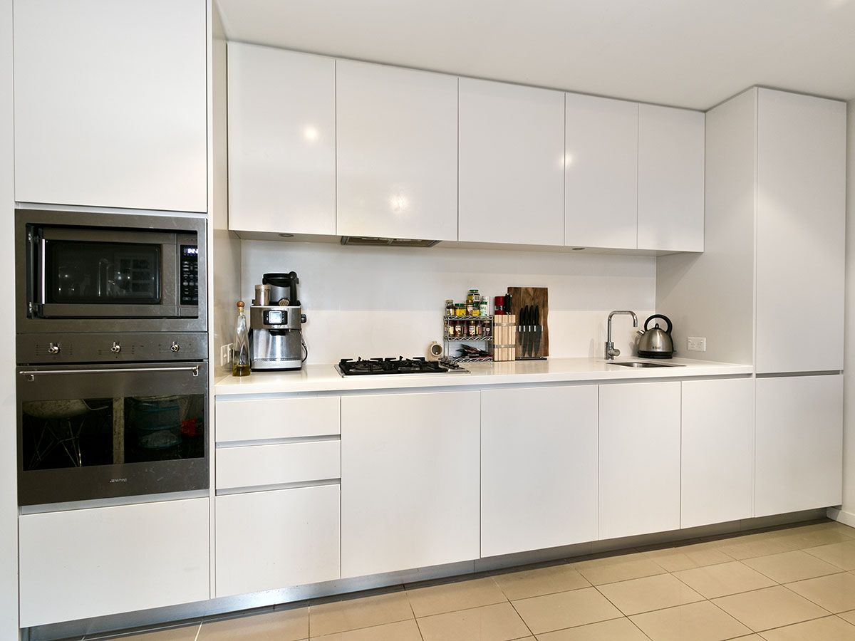 Beau Leonard Avenue Kitchen: Straight Style, All White, Stainless Steel Plinths.
