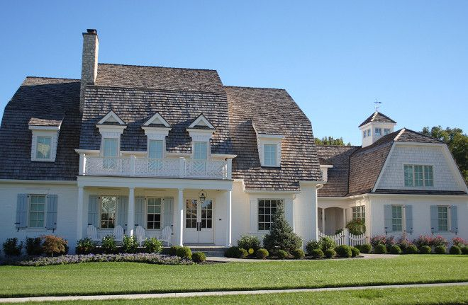 This Grambrel Roof Estate Features Cedar Shakes With