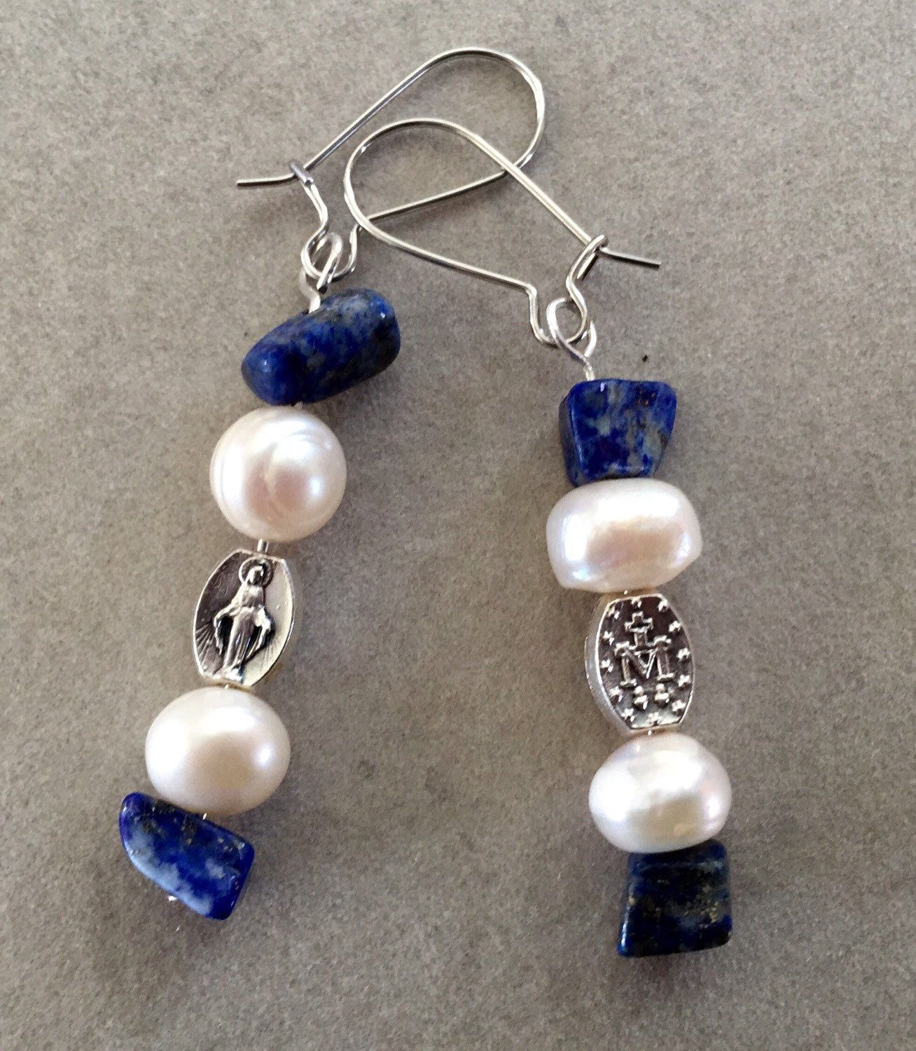 Pearl and Lapis Miraculous Medal Earrings by AveMariaFaithcrafts on Etsy https://www.etsy.com/listing/260759217/pearl-and-lapis-miraculous-medal