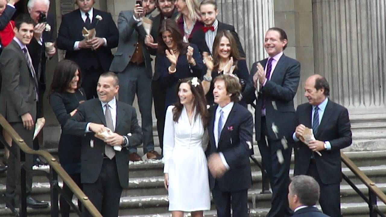 Sir Paul McCartney and Nancy Shevell coming out of Marylebone register office, London UK having just got married 9th October 2011