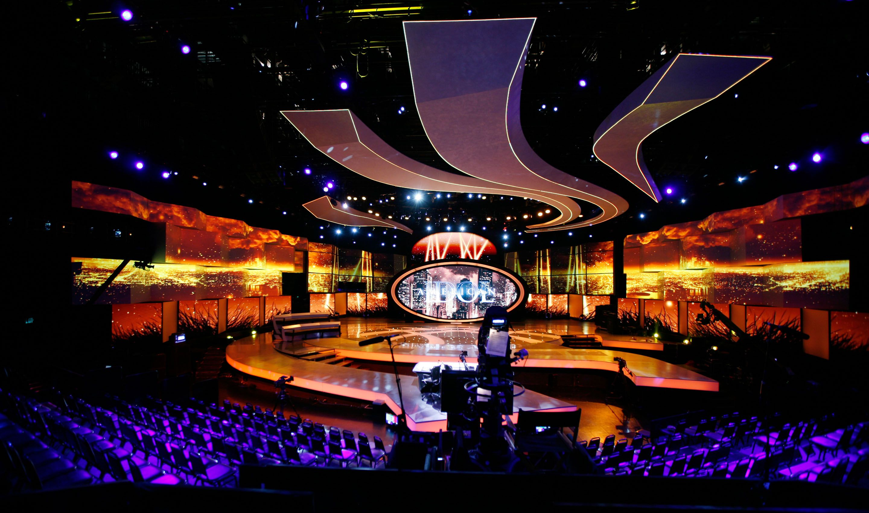 stage set design with large decorative shapes and lighting - Concert Stage Design Ideas