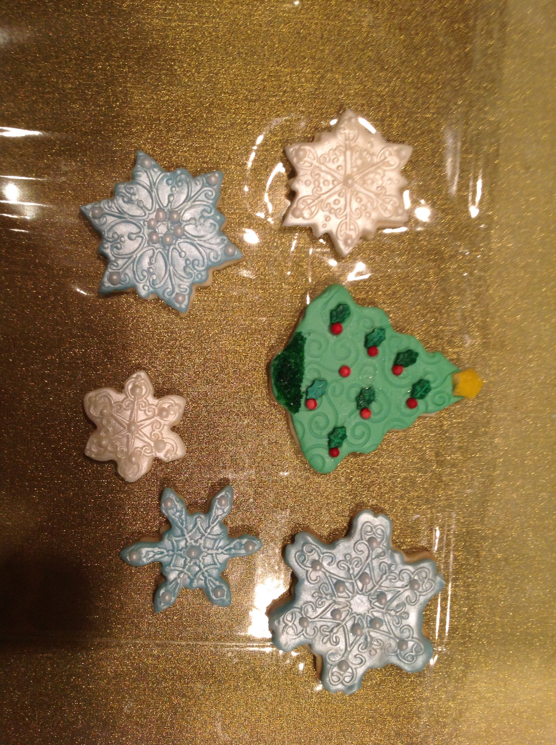 Christmas cookies decorated with fondant.