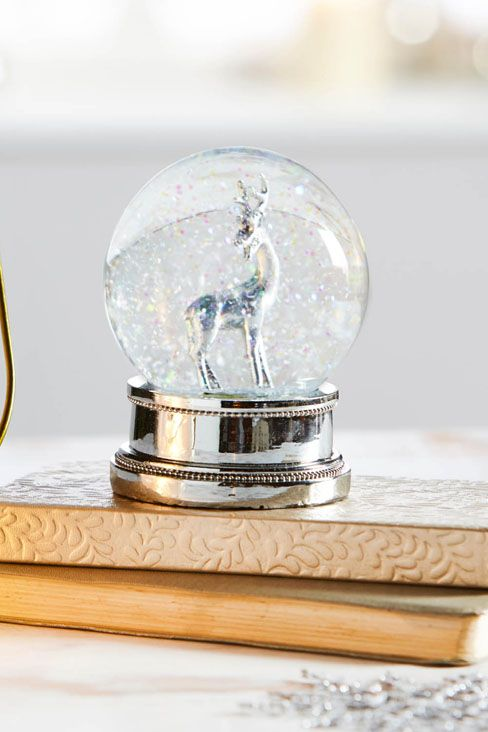 Reindeer Snow Globe £15 Beautiful silver reindeer in snow globe. Made from glass and polyresin. H10 x diam. 7.6cm