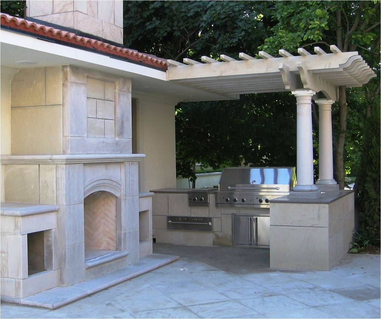 Dual purpose #patio - #Fireplace and #grill creatively designed by Paramount #Landscaping